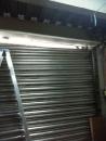 鐵捲門維修,門片斷裂修理,鐵門維修