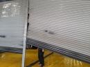 鐵捲門反捲,捲門卡住變形,修理鐵捲門,維修電動鐵捲門